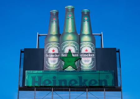 AMSTERDAM, NETHERLANDS - JULY 18, 2018: Large billboard of Heineken lager beer on blue sky background Editoriali