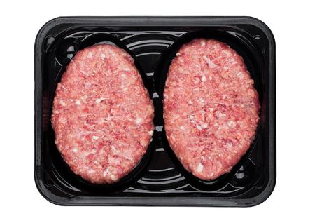 Raw fresh beef venison steak in plastic tray on white background