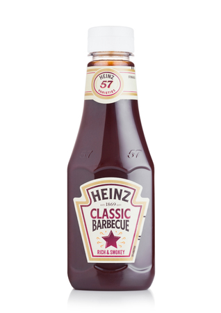 LONDON, UK - JULY 28, 2018: A bottle of Heinz Classic Barbecue on white background. Editoriali