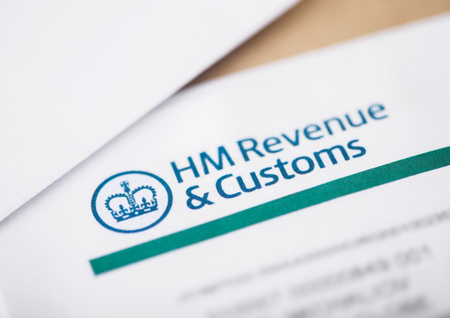 LONDON, UK - AUGUST 18, 2018: HM revenue & Customs statement with envelopes closeup 報道画像