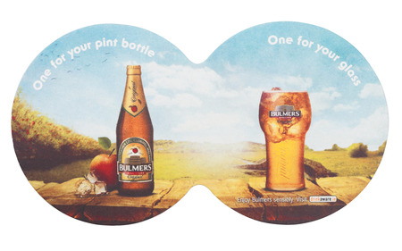 LONDON, UK - AUGUST 22, 2018: Bulmers Cider original paper mat coaster isolated on white background. Redactioneel