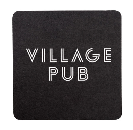LONDON, UK - AUGUST 22, 2018: Village Pub paper beer beermat coaster isolated on white background.