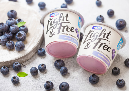 LONDON, UK - SEPTEMBER 26, 2018: Light and Free greek style yogurt with blueberries by Danone with berries