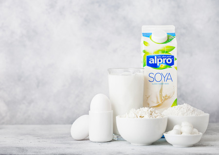 LONDON, UK - OCTOBER 07, 2018 : Plastic bottle of Alpro Soya milk, bowl of cottage cheese and baking flour and cheese Redakční