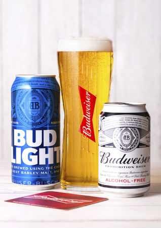 LONDON, UK - APRIL 27, 2018: Aluminium cans of Budweiser Bud Light Beer on wooden background with label, an American lager first introduced in 1876.