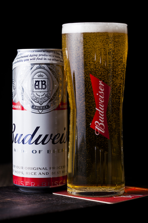 LONDON, UK - FEBRUARY 06, 2019: Aluminium can of Budweiser Beer on wooden background with label, an American lager first introduced in 1876.