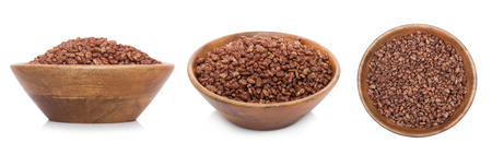 Bamboo wood bowl with natural organic granola cereal chocolate flakes on white.Top view