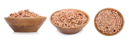 Bamboo wood bowl with natural organic granola cereal summer fruits flakes on white.Top view Stock Photo