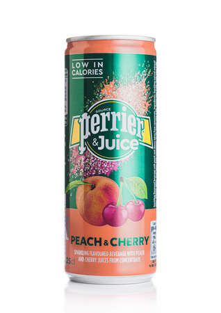 LONDON, UK - MAY 29, 2019: Aluminium can of Perrier and Juice with peach and cherry flavour on white.