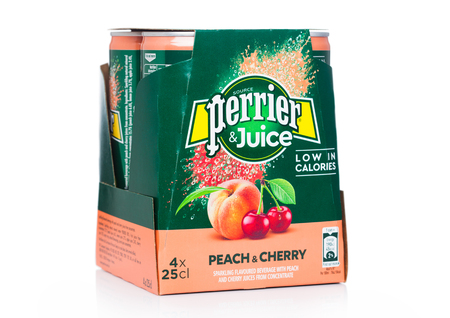 LONDON, UK - MAY 29, 2019: Pack of Perrier and Juice with peach and cherry flavour on white. Redactioneel