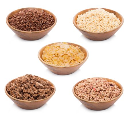 Bamboo wooden bowl with natural organic granola cereal with different breakfast cereal
