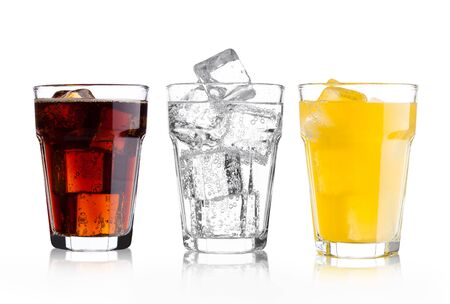 Glasses of cola and orange soda drink and lemonade sparkling water on white background with ice cubes Zdjęcie Seryjne