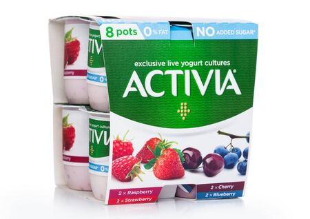 LONDON, UK - AUGUST 18, 2019: Pack of Activia exclusive live yogurt cultures with berries on white background. Low fat no added sugar