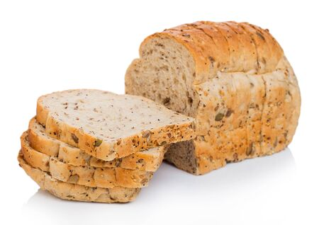 Cut of fresh loaf of seeded bread on white. Traditional bakery heritage. Stok Fotoğraf
