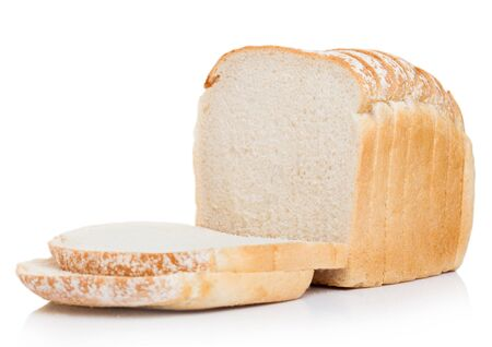 Cut of fresh loaf of white bread on white. Traditional bakery heritage. Stok Fotoğraf