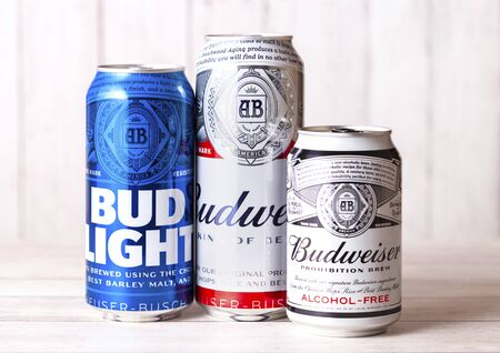 LONDON, UK - APRIL 27, 2018: Aluminium can of Budweiser Bud Light and Non Alcoholic  Beer on wooden background.An American lager first introduced in 1876. Editorial