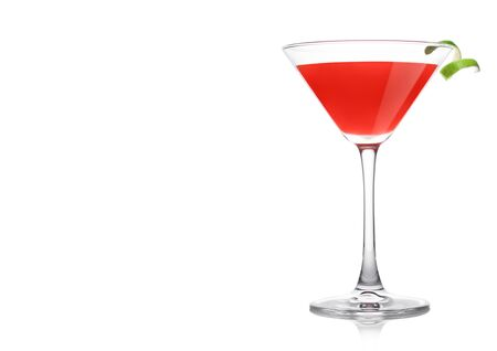 Cosmopolitan cocktail in classic crystal glass with lime peel on white background. Space for text Stock Photo
