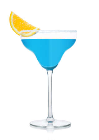 Blue summer cocktail in margarita glass with orange slice on white background.