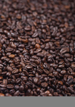 Fresh raw organic coffee beans top view background. Macro