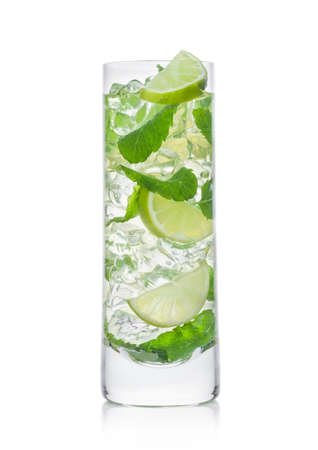 Highball glass of Mojito summer alcoholic cocktail with ice cubes mint and lime on white background.