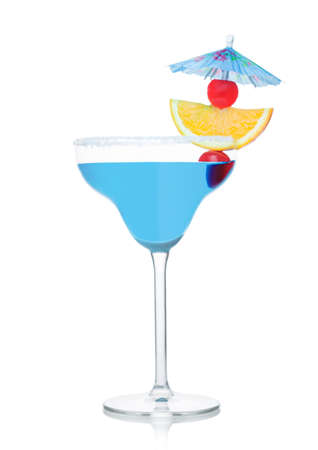 Blue summer cocktail in margarita glass with orange slice and sweet cherry with umbrella on white background. Reklamní fotografie