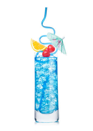 lagoon cocktail highball glass with straw and orange slice with sweet cherry and umbrella on white background. Vodka and blue curacao liqueur mix.