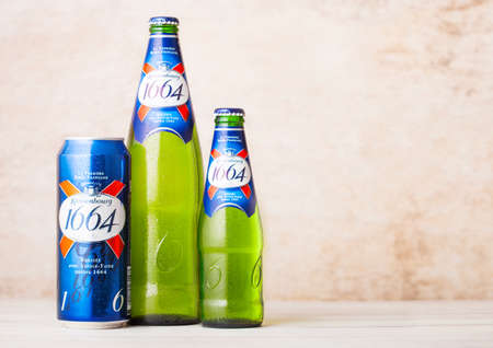 LONDON, UK - AUGUST 10, 2018: Cold bottles and aluminum can of Kronenbourg 1661 beer on wood background.