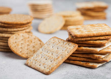 Stack of various organic crispy wheat, rye and corn flatbread crackers with sesame and salt on light background Reklamní fotografie