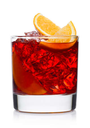 Negroni Cocktail in modern glass with ice cubes and orange slices on white background
