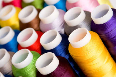 Hanks of multi-coloured threads for embroidery on a white background photo