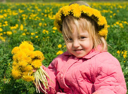 Portrait of the little girl with a wreath from dandelions on a head Stock Photo - 4801474