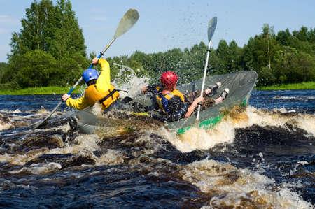 Kayaker sporting a kayak cuts through water photo
