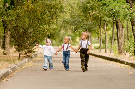 Three young friends go for a walk the park Stock Photo - 5643606