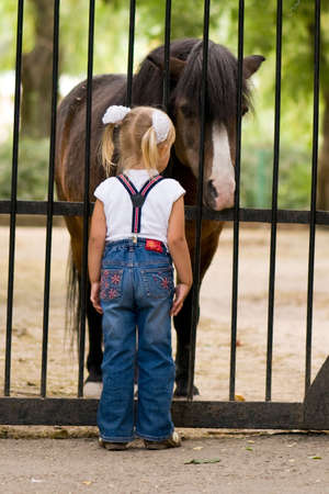 pony girl: 3 year old girl and small pony