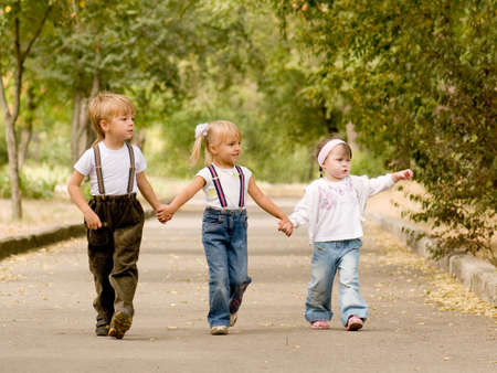 Three young friends go for a walk the park photo
