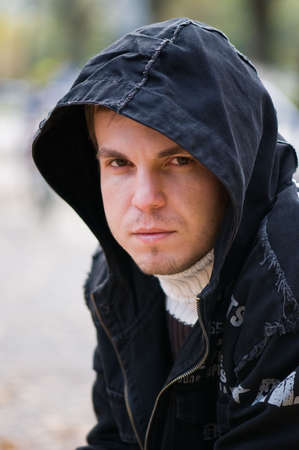 Handsome young man in a black hood Stock Photo - 5725099