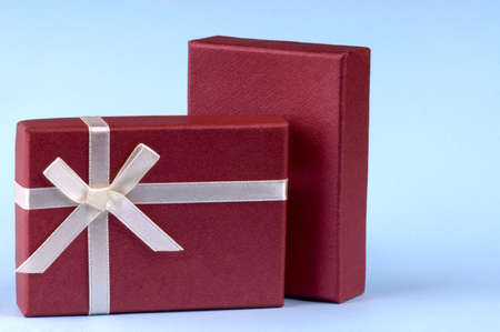 Two red gift box with white ribbon and bow photo