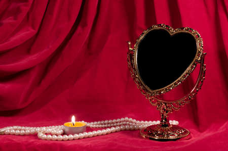 Mirror in the form of heart, pearly necklace, light. Valentines day card. photo