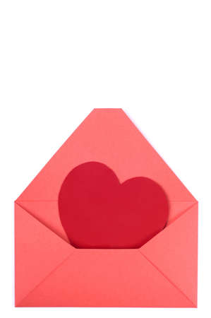 A red heart in a opened red envelope. Valentines day card. photo
