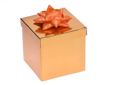 Golden gift box with red ribbon and bow isolated photo