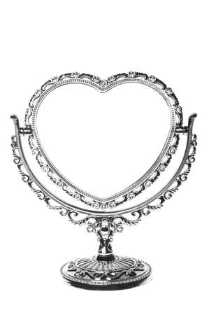 Mirror in the form of heart isolated on white background photo