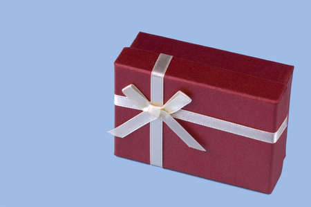 One red gift box with white ribbon and bow isolated photo