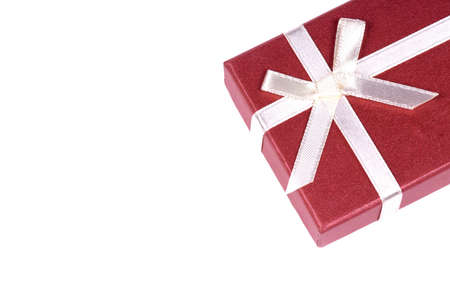 One red gift box with white ribbon and bow and isolated photo