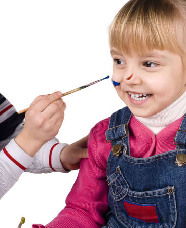Beautiful little girl and boy is drawing with gouaches photo