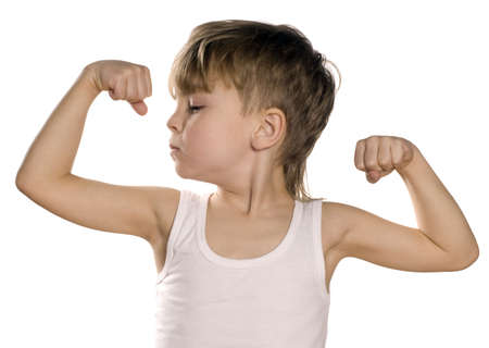 child model: Portrait of little european boy flexing biceps. Beautiful caucasian model. Isolated on white background.
