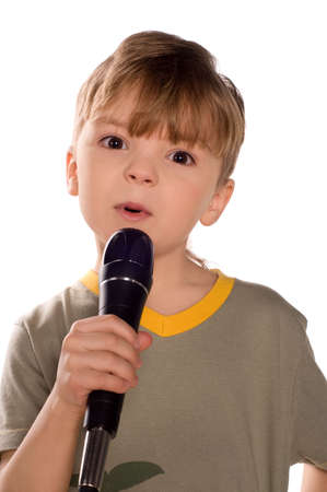 child singing: Child singing with a microphone. Funny little boy isolated on white background. Beautiful caucasian model.