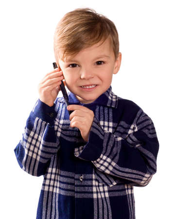 Funny little european boy speaks over cell phone. Beautiful caucasian model. Isolated on white background. photo