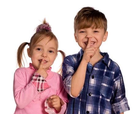 shhh... Funny little boy and girl. Good for borders of articles or websites. Beautiful caucasian model. Isolated on white background. photo