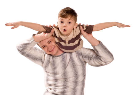 Portrait of loving father and his child cuddling on white background. Beautiful caucasian models. photo
