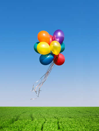 Bunch of colorful balloons in the blue sky photo